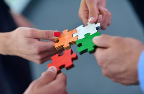 Group,Of,Business,People,Assembling,Jigsaw,Puzzle,And,Represent,Team
